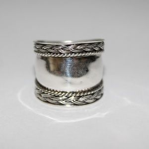 Sterling silver ring  braided design sz.7.5